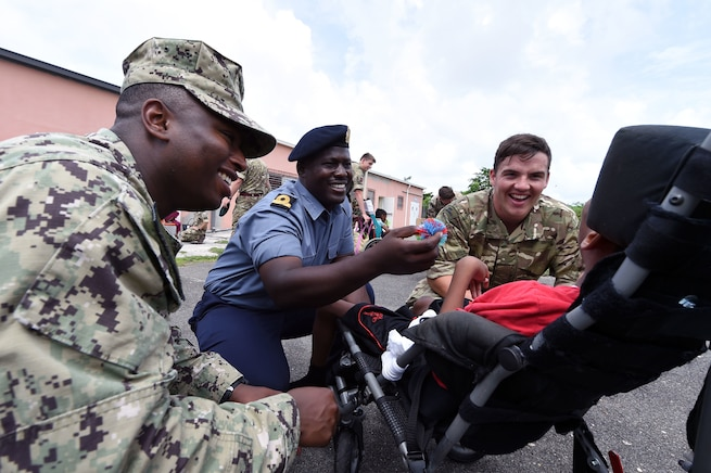 Troops interact with a child in the Bahamas.