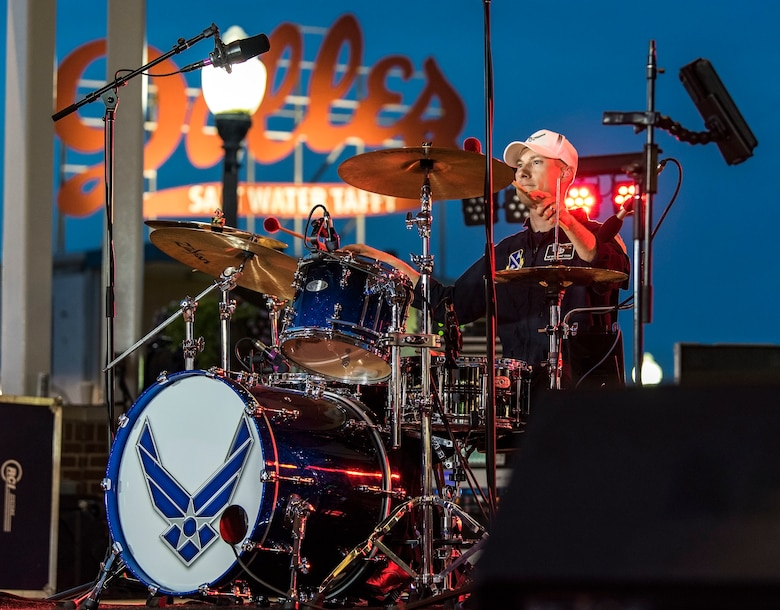 Tech. Sgt. Gabriel Staznik, Max Impact drummer, sets the beat for the band June 16, 2018, on the bandstand at Rehoboth Beach, Del. Staznik is the newest member with the band and has the additional duty as non-commissioned officer in charge of Max Impact operations. Max Impact, the premier rock band of the U.S. Air Force, is stationed at Joint Base Anacostia-Bolling in Washington, D.C. (U.S. Air Force photo by Roland Balik)
