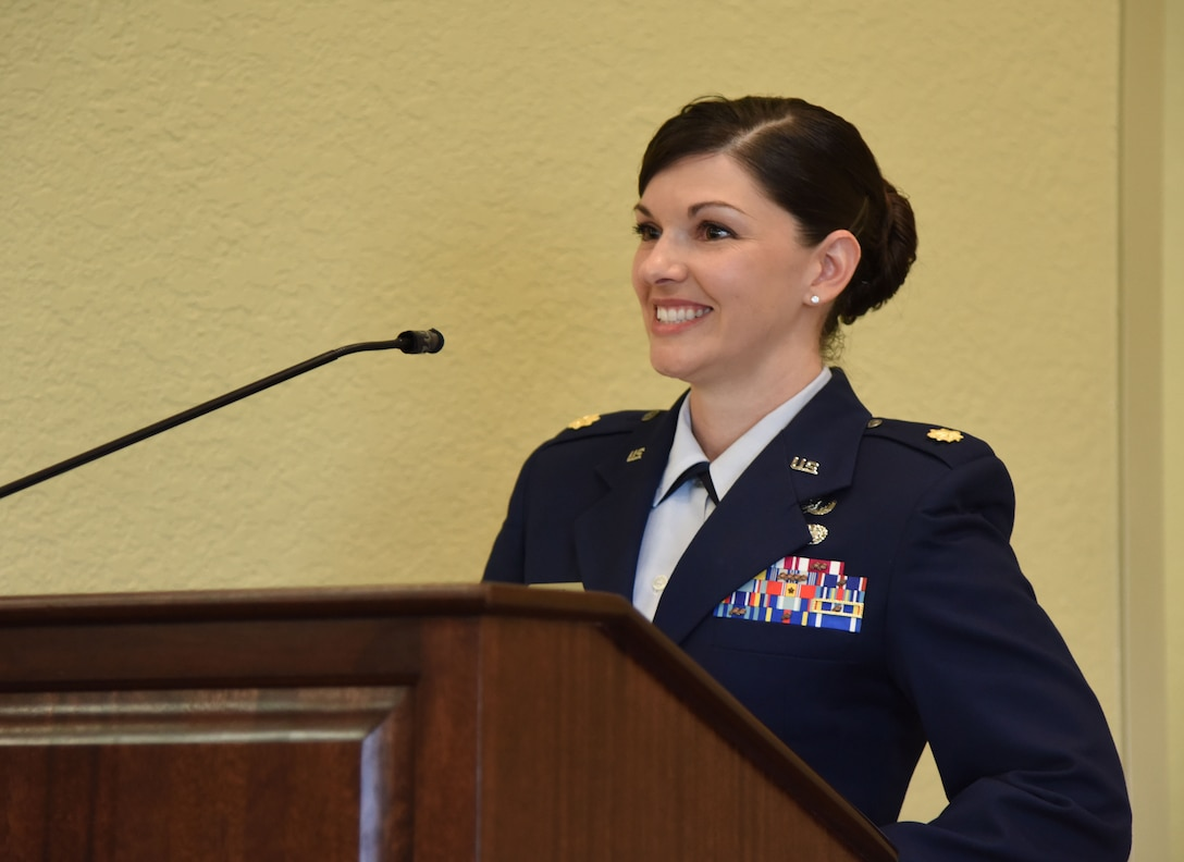 U.S. Air Force Maj. Amber Ortiz, incoming 81st Force Support Squadron commander, delivers remarks during the 81st FSS change of command ceremony in the Bay Breeze Event Center at Keesler Air Force Base, Mississippi, June 14, 2018. Ortiz assumed command of the 81st FSS from Lt. Col. Teresa Ammons. (U.S. Air Force photo by Kemberly Groue)