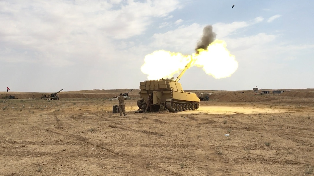 Iraqi Security Forces fire at known ISIS locations near the Iraqi-Syrian border using an M109A6 Paladin Self-Propelled Howitzer, June 5, 2018. Iraqi Security Forces and Coalition partners provided fire support as they continued Operation Roundup, the military offensive to rid the final pockets of the terrorist organization from the Middle Euphrates River Valley in Syria. (U.S. Army photo by Spc. Anthony Zendejas IV)
