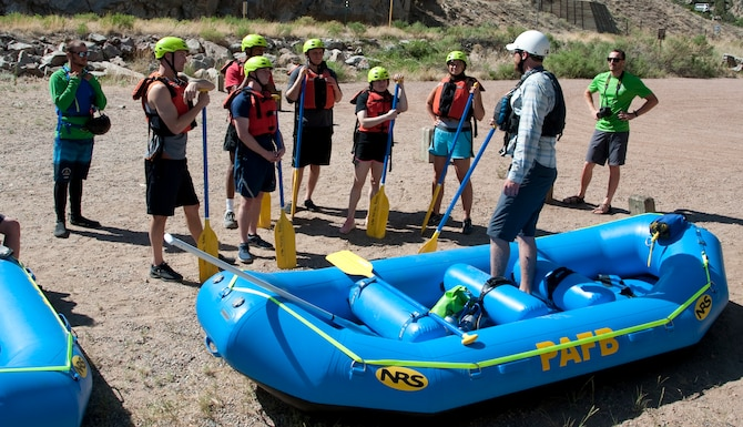 PETERSON AIR FORCE BASE, Colo. – Airmen from Peterson Air Force Base, Colorado, and Schriever Air Force Base, Colorado, listen to a safety brief before whitewater rafting June 8, 2018, in Cañon City, Colorado. The chaplain-sponsored rafting excursion allowed Airmen the opportunity to use their resiliency skills to face everyday challenges. (U.S. Air Force photo by Staff Sgt. Emily Kenney)