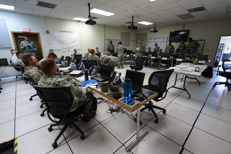 Airmen prepare for a readiness exercise on June 14, 2018, on Grand Forks Air Force Base, North Dakota. Readiness exercises ensure Airmen are prepared to deploy when called upon and provide an opportunity to hone the skills needed to quickly process Airmen. (U.S. Air Force photo by Airman 1st Class Melody Wolff)