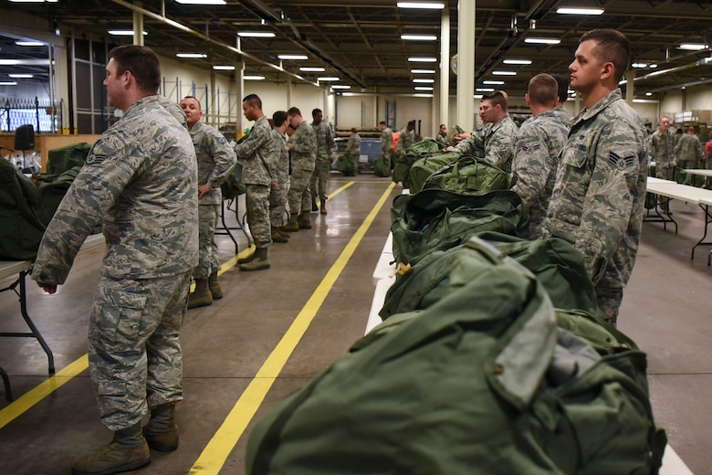 Airmen prepare for a readiness exercise June 14, 2018, on Grand Forks Air Force Base, North Dakota. In this preparation step, Airmen were instructed to ensure they had the proper equipment in their bags for the exercise. (U.S. Air Force photo by Airman 1st Class Melody K. Wolff)