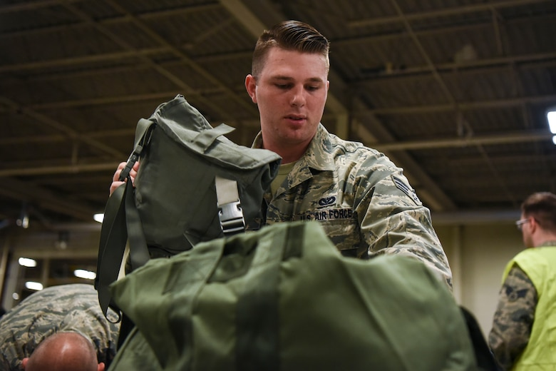 Senior Airman Patrick Archer, a 319th Civil Engineer Squadron pest management journeyman, prepares his bag for a readiness exercise June 14, 2018, on Grand Forks Air Force Base, North Dakota. Archer, along with other Airmen, were given a check list of the necessary items to be fully prepared for the exercise. (U.S. Air Force photo by Airman 1st Class Melody K. Wolff)