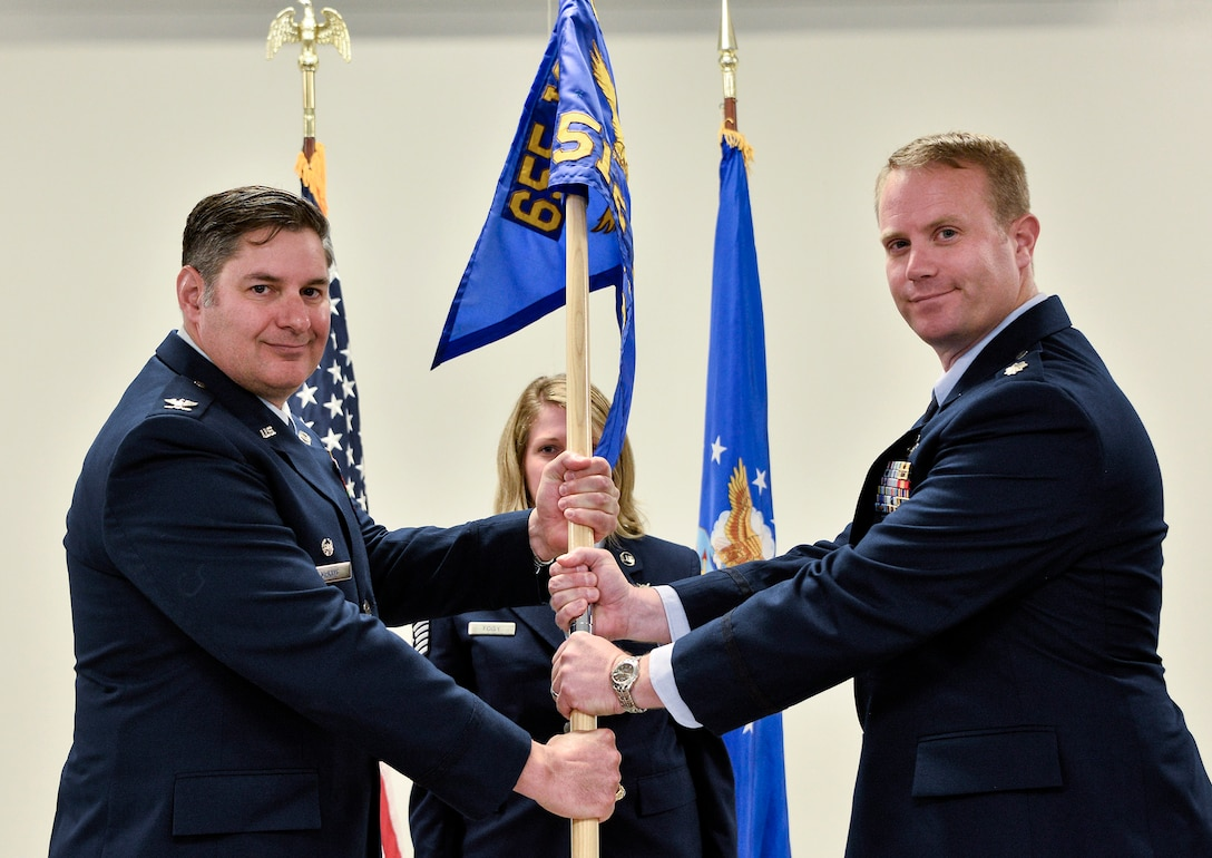 Lt. Col. Daniel Dunn, right, assumes command of the 512th Cyber Intelligence Squadron, 655th Intelligence, Surveillance and Reconnaissance Group, during a change of command ceremony June 10, 2018.