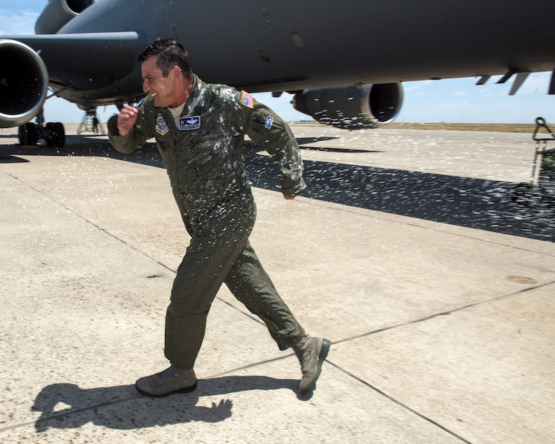 U.S. Air Force Master Sgt. Scott Dillinger, 6th Air Refueling Squadron noncommissioned officer in charge of standardization and evaluation and a KC-10 Extender flight engineer, arrives at Travis Air Force Base, Calif., June 6, 2018. Dillinger eclipsed the 10,000 flight hour mark and was greeted by family, friends and coworkers. (U.S. Air Force photo by Louis Briscese)
