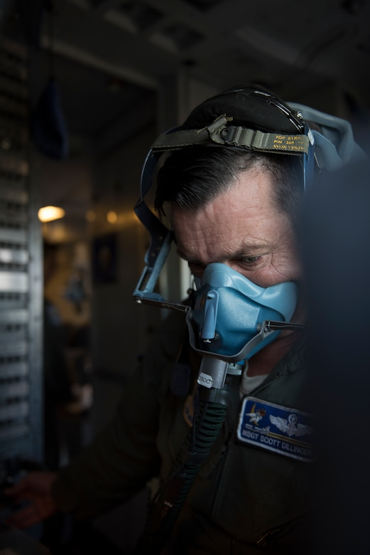 Master Sgt. Scott Dillinger, 6th Air Refueling Squadron noncommissioned officer in charge of standardization and evaluation and a KC-10 Extender flight engineer, conducts a check of an oxygen mask inside the cockpit of a KC-10 at Eielson Air Force, Base, Alaska, June 6, 2018. Dillinger and his crew flew the aircraft to support refueling operations in the Pacific theater. During the five-day mission, Dillinger surpassed 10,000 flight hours. (U.S. Air Force photo by Tech. Sgt. James Hodgman)