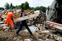 Approximately 40 volunteers devoted their time to help clean up Dudeldorf after a flood hit the village.