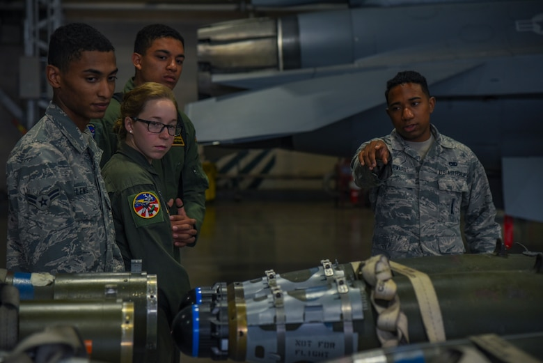 U.S. Air Force Senior Airman Farhan Howard, a 35th Maintenance Group weapons lead crew member, showcases munitions to visiting United States Air Force Academy cadets at Misawa Air Base, Japan, June 13, 2018. The cadets visited various squadrons around base as part of Operation Air Force, a two-week visit that allowed the cadets to see career fields available to them upon graduation from the Academy. (U.S. Air Force photo by Airman 1st Class Collette Brooks)