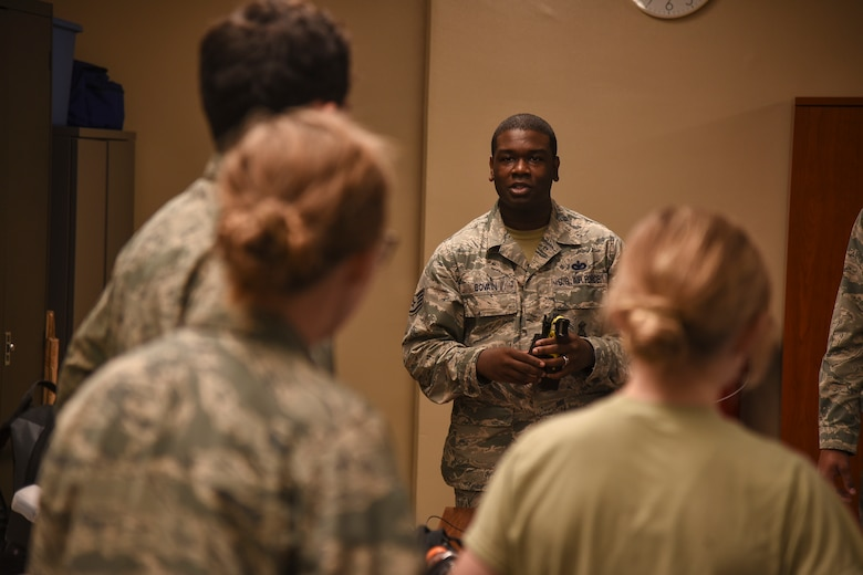 U.S. Air Force Staff Sgt. James Bovain, a 35th Security Forces Squadron trainer, speaks to visiting Air Force Academy cadets about daily responsibilities the 35th SFS fulfills during a tour at Misawa Air Base, Japan, June 18, 2018. These future Air Force officers visited Misawa AB as part of an annual program showcasing operational bases around the world. (U.S. Air Force photo by Airman 1st Class Collette Brooks)