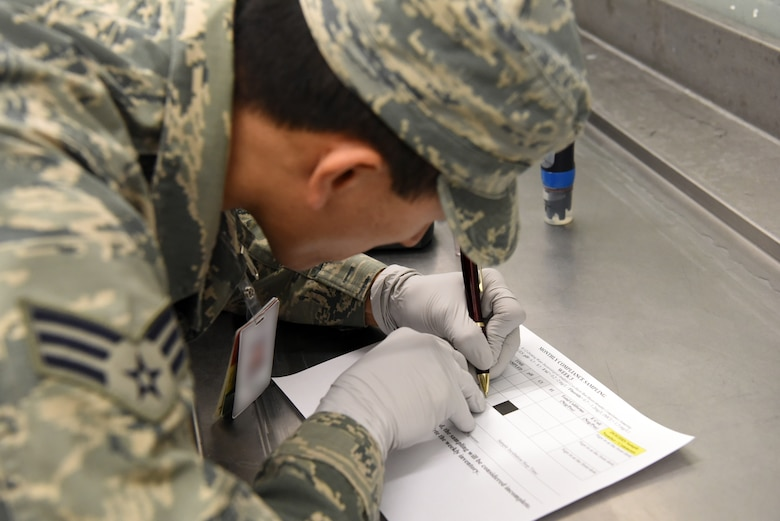 An Airman assigned to the 48th Aerospace Medicine Squadron Bioenvironmental Engineering flight confirms the results of a water acidity test at Royal Air Force Lakenheath, England, June 19, 2018. The 48th AMDS, Bioenvironmental Engineering flight uses engineering principles to check for pollutants and radioactive materials, implementing environmental protections, monitoring OSHA and NRC work safety standards and permits, and other duties to reduce health risks and dangers to Airmen.  (U.S. Air Force photo/ Airman 1st Class John A. Crawford)