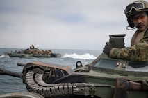U.S. Marine Sgt. Bryan Perdigon, an assault amphibian Marine with Battalion Landing Team 3/1, 13th Marine Expeditionary Unit, surveys the sea from his turret while at sea, June 13, 2018. The Essex Amphibious Ready Group and 13th MEU are conducting Composite Training Unit Exercise, the final exercise before the units' upcoming deployment. This exercise validates the ARG/MEU team's ability to adapt and execute missions in ever-changing, unknown environments. Upon completion of COMPTUEX, the 13th MEU and Essex ARG will be certified as the nation's premier forward-deployed, crisis response force, capable of executing missions across the broad spectrum of military operations.