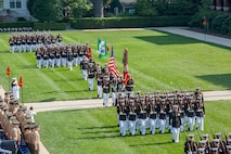 Marines with Marine Barracks Washington D.C. execute pass and review during  a Troop Review Ceremony to honor military officials from Brazil and Mexico at the Barracks, June 18, 2018. The Barracks hosted our Brazilian and Mexican military counterparts to honor Commandant of the Brazil Corps of Naval Infantry, Adm. Alexandre Jose Barreto de Mattos, and Coordinator General, Mexico Naval Infantry, Vice Adm. Rafael Lopez Martinez.