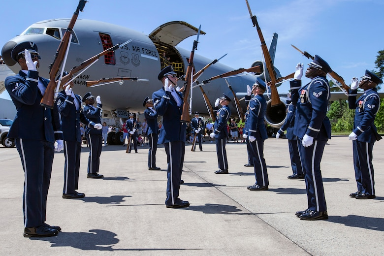 The U.S. Air Force Honor Guard Drill Team performs in front of visitors at the Innovations in Flight Family Day and Outdoor Aviation Display at the Steven F. Udvar-Hazy Center, Chantilly, Virginia, June 16, 2018. A standard Drill Team performance includes a sequence of weapon maneuvers, tosses, exchanges, and a walk through the gauntlet of spinning bayoneted rifles. (U.S. Air Force photo by Master Sgt. Mark C. Olsen)