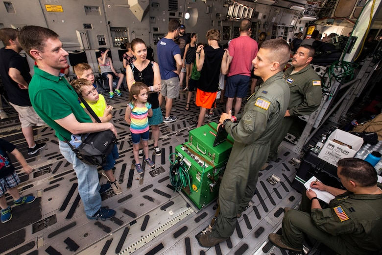 U.S. Air Force 1st Lt. Jedd Dillman, green flight suit standing right, a flight nurse with the 514th Aeromedical Evacuation Squadron (AES), 514th Air Mobility Wing, answers visitors questions about the AES mission and the C-17 Globemaster III during the Innovations in Flight Family Day and Outdoor Aviation Display at the Steven F. Udvar-Hazy Center, Chantilly, Virginia, June 16, 2018. A KC-10 Extender and a C-17 crewed by Reserve Citizen Airmen with the 78th Air Refueling Squadron and the 732nd Airlift Squadron, both with the 514th Air Mobility Wing, participated in the event at the Center. The 514th is an Air Force Reserve Command unit located at Joint Base McGuire-Dix-Lakehurst, N.J. (U.S. Air Force photo by Master Sgt. Mark C. Olsen)