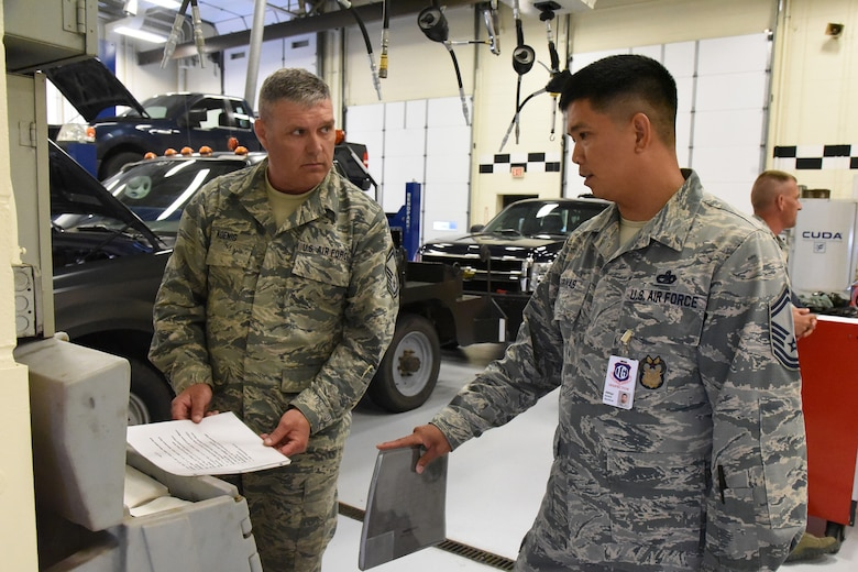 Senior Master Sgt. Arwin Sarinas, of the Air Combat Command (ACC) inspector general team, right, discusses unit standards and practices with Senior Master Sgt. Steve Koenig, the 119th Logistics Readiness Squadron vehicle maintenance superintendent, during a unit effectiveness inspection (UEI) at the North Dakota Air National Guard Base, Fargo, N.D., May 19, 2018.