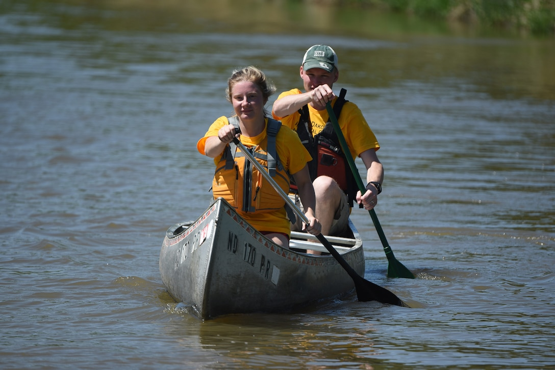 Senior Airman Maggie Swenson, front, and Senior Airman Joel 'Braxton' Aldridge, both members of the North Dakota Air National Guard junior enlisted advisory council (JEAC), paddle a canoe on the Sheyenne River during a leadership retreat at Fort Ransom State Park, near Fort Ransom, N.D., June 4, 2018.