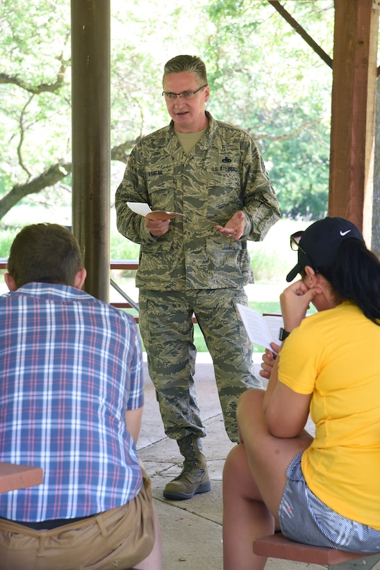 Chief Master Sgt. Duane Kangas, the 119th Wing command chief, standing, visits with members of the of the North Dakota Air National Guard junior enlisted advisory council (JEAC), during a leadership retreat at Fort Ransom State Park, near Fort Ransom, N.D., June 4, 2018.