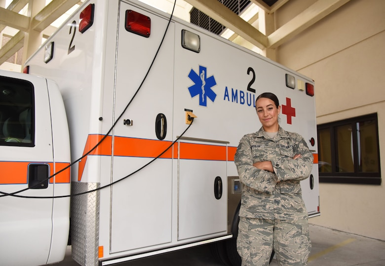 U.S. Air Force Tech. Sgt. Juliet Corcillo, 81st Medical Operations Squadron Emergency Department NCO in charge, poses for a photo in front of an ambulance outside of the Keesler Medical Center at Keesler Air Force Base, Mississippi, June 14, 2018. Corcillo was awarded a full ride scholarship to medical school from the Air Force's Health Professions Scholarship Program. (U.S. Air Force photo by Kemberly Groue)