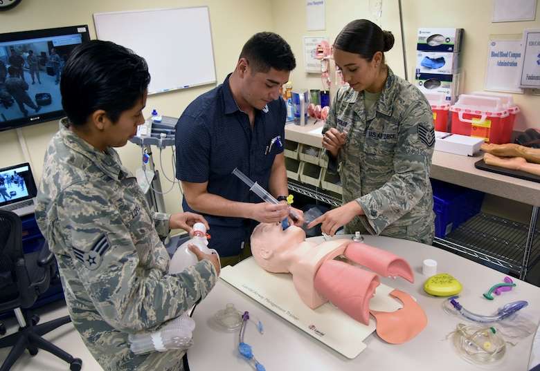 U.S. Air Force Tech. Sgt. Juliet Corcillo, 81st Medical Operations Squadron Emergency Department NCO in charge, conducts a respiratory training session with Senior Airman Lupita Lopez, 81st Aerospace Medicine Squadron medical technician, left, and Airman 1st Class Enrique Padron, 81st MDOS medical technician, in the Keesler Medical Center at Keesler Air Force Base, Mississippi, June 14, 2018. Corcillo was awarded a full ride scholarship to medical school and will begin her first day July 6 with a four-year scholarship from the Air Force's Health Professions Scholarship Program. (U.S. Air Force photo by Kemberly Groue)