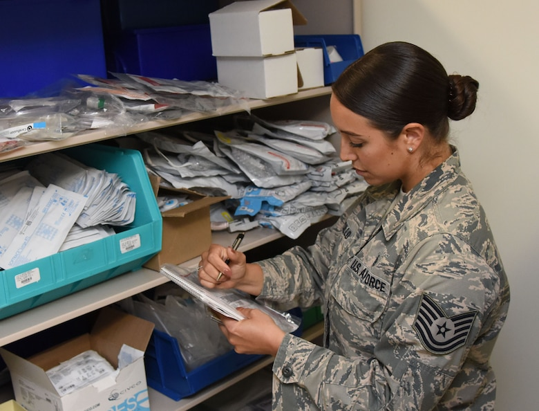 U.S. Air Force Tech. Sgt. Juliet Corcillo, 81st Medical Operations Squadron Emergency Department NCO in charge, completes a daily supply inventory list for the Keesler Medical Center emergency department at Keesler Air Force Base, Mississippi, June 14, 2018. Corcillo will begin her first day of medical school July 6 with a four-year scholarship from the Air Force's Health Professions Scholarship Program. (U.S. Air Force photo by Kemberly Groue)