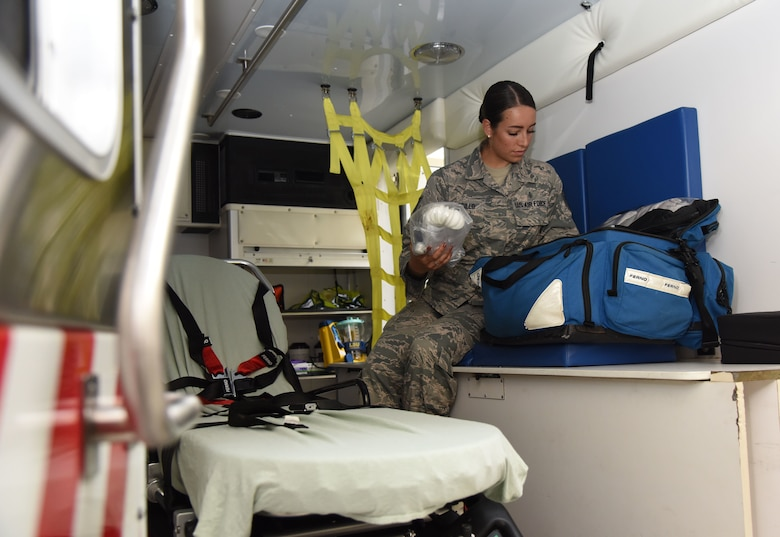 U.S. Air Force Tech. Sgt. Juliet Corcillo, 81st Medical Operations Squadron Emergency Department NCO in charge, conducts a daily function check inside an ambulance at Keesler Air Force Base, Mississippi, June 14, 2018. Corcillo will begin her first day of medical school July 6 with a four-year scholarship from the Air Force's Health Professions Scholarship Program. (U.S. Air Force photo by Kemberly Groue)
