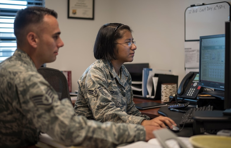 U.S. Air Force Staff Sgt. Blake Martin, a contracting supervisor and Airman 1st Class Gabrielle Dimaio, a contracting specialist, both assigned to the 6th Contracting Squadron (CONS), review a training plan for the new Contracting Information Technology (CON-IT) system at MacDill Air Force Base, Fla., June 20, 2018.