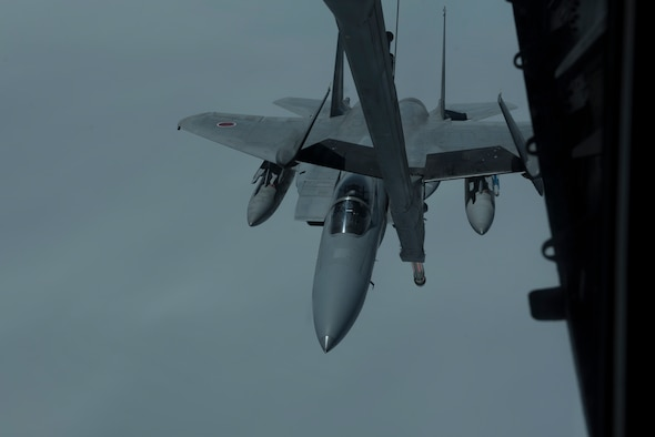 An F-15 is refueled by a U.S. Air Force KC-10 Extender from Travis Air Force Base, Calif., during a mission in the Indo-Pacific theater June 4, 2018. The KC-10 refueled six fighters from the Japan Air Self-Defense Force offloading more than 130,000 pounds of fuel enabling them to fly more than 2,900 nautical miles from Japan to Alaska. (U.S. Air Force photo by Tech. Sgt. James Hodgman)