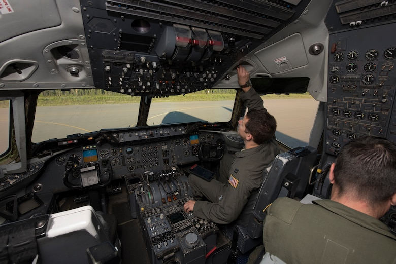 U.S. Air Force Capt. Eddie Miller, 6th Air Refueling Squadron assistant flight commander for the mission support flight and a KC-10 aircraft commander, conducts a flight controls check in the cockpit of a KC-10 at Eielson Air Force Base, Alaska, June 6, 2018. The aircraft completed a five-day mission which featured refueling U.S. Air Force F-15C Eagles and Japan Air Self-Defense Force fighter aircraft in the Indo-Pacific Command area of operations. (U.S. Air Force photo by Tech. Sgt. James Hodgman)