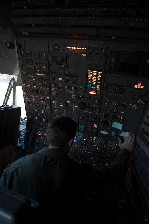 U.S. Air Force Staff Sgt. Ben Clouse, 6th Air Refueling Squadron KC-10 Extender flight engineer, conducts a check of flight systems inside a KC-10 at Travis Air Force Base, Calif., June 1, 2018. The aircraft completed a five-day mission which featured refueling U.S. Air Force and Japan Air Self-Defense Force fighter aircraft in the Indo-Pacific Command area of operations. (U.S. Air Force photo by Tech. Sgt. James Hodgman)