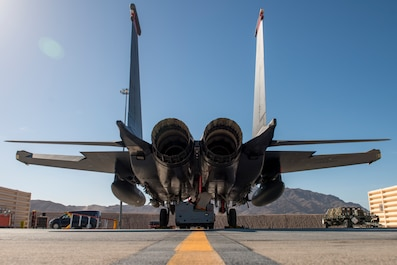 A 391st Fighter Squadron crew chief troubleshoots an F-15E Strike Eagle starter during Green Flag West, June 11, 2018, at Nellis Air Force Base, Nevada. The 391st FS participated in Green Flag to further enhance readiness by training on Close Air Support over the National Training Center, Fort Irwin, California. (U.S. Air Force photo by Airman 1st Class JaNae Capuno)