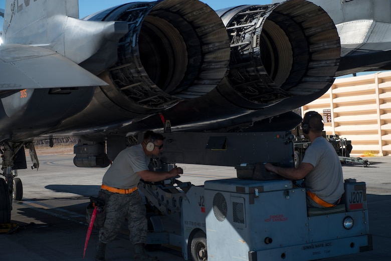 391st Fighter Squadron crew chiefs operate a jammer to remove a section of an F-15E Strike Eagle during Green Flag West, June 11, 2018, at Nellis Air Force Base, Nevada. The 391st FS participated in Green Flag to further enhance readiness by training on Close Air Support over the National Training Center, Fort Irwin, California. (U.S. Air Force photo by Airman 1st Class JaNae Capuno)