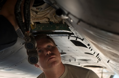 Tech. Sgt. Tyler Borgstrom, 391st Fighter Squadron crew chief, inspects an F-15E Strike Eagle central gearbox jet fuel starter during Green Flag West, June 11, 2018, at Nellis Air Force Base, Nevada. The 391st FS participated in Green Flag to further enhance readiness by training on Close Air Support over the National Training Center, Fort Irwin, California. (U.S. Air Force photo by Airman 1st Class JaNae Capuno)
