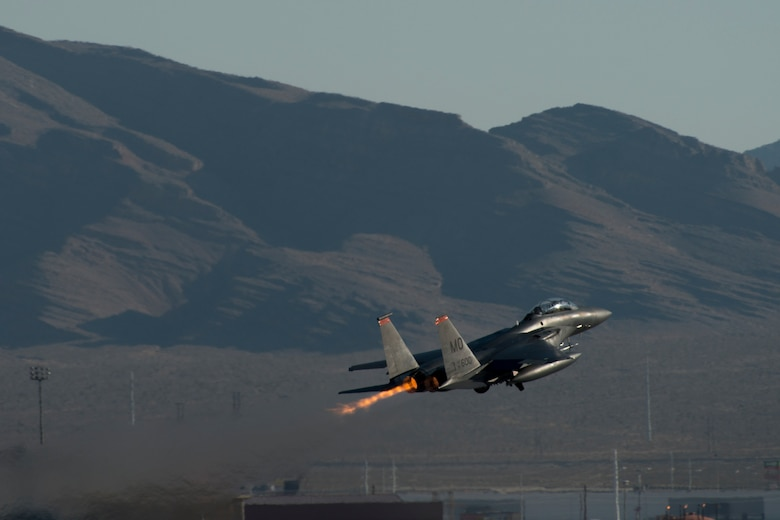 An 391st Fighter Squadron F-15E Strike Eagle takes off during Green Flag West, June 13, 2018, at Nellis Air Force Base, Nevada. The 391st FS participated in Green Flag to further enhance readiness by training on Close Air Support over the National Training Center, Fort Irwin, California. (U.S. Air Force Photo by Airman 1st Class JaNae Capuno)