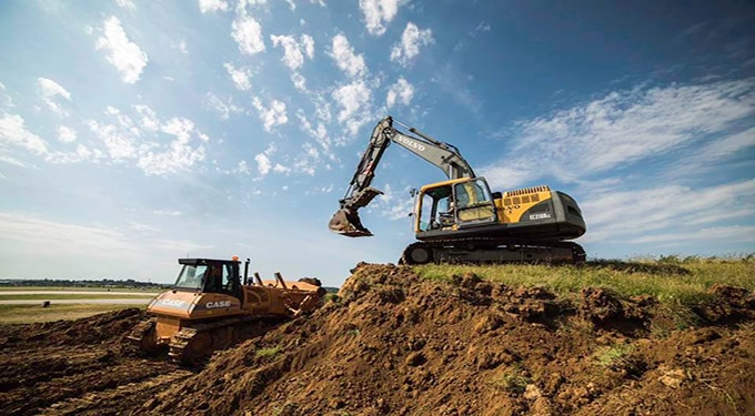 Staff Sgt. Shannon Feliccia, 188th Civil Engineer Squadron heavy equipment operator, operates the crawl tractor and Senior Airman Adam Brannon, 188th CES heavy equipment operator, operates an excavator June 24, 2016, to remove dirt from the West Hammerhead Arm/Dearm berm at Ebbing Air National Guard Base, Fort Smith, Ark. The 188th CES removed 1,400 cubic yards of dirt by the end of the weekend and plan to remove the rest of the berm in August. (U.S. Air National Guard photo by Senior Airman Cody Martin/Released)