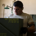 Staff Sgt. Kevin Mejia, 57th Equipment Maintenance Squadron conventional crew member, prepares an munitions crate for loading during Green Flag West, June 11, 2018, at Nellis Air Force Base, Nevada. The 366th EMS augmented 57th EMS Airmen during Green Flag. This exercise enhanced readiness by providing Close Air Support training over the National Training Center, Fort Irwin, California. (U.S. Air Force photo by Airman 1st Class JaNae Capuno)