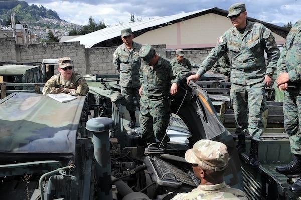 U.S. and Ecuadorean military members talk.