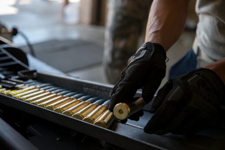 An Airman from the 57th Equipment Maintenance Squadron places a 20 millimeter ammunition into a universal loading system during Green Flag West, June 11, 2018, at Nellis Air Force Base, Nevada. The 366th EMS augmented 57th EMS Airmen during Green Flag. This exercise enhanced readiness by providing Close Air Support training over the National Training Center, Fort Irwin, California. (U.S. Air Force photo by Airman 1st Class JaNae Capuno)