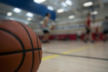 Team Shaw Airmen warm up before the Four Chaplains 3-on-3 Basketball Tournament at the 20th Force Support Squadron main fitness center at Shaw Air Force Base, S.C., June 15, 2018.