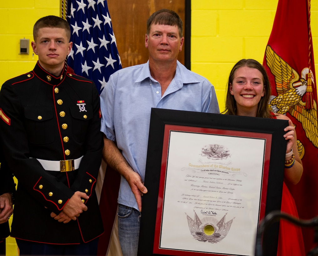 Hunter A. Northcutt's father, Marty Northcutt, sister, Tori Northcutt, and cousin, Pfc. Gavin G. Northcutt, hold the Honorary Marine award (posthumously) for Hunter at Pelham Elementary School, Pelham, Tennessee, June 13, 2018. Hunter perished from acute leukemia on September 18, 2017 at just 15 years old. (U.S. Marine Corps photo by Sgt. Mandaline Castillo)