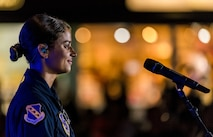 """Tech. Sgt. Nalani Quintello, Max Impact vocalist, looks out towards the audience June 16, 2018, on the bandstand at the Rehoboth Beach, Del. Quintello was a former contestant on the television show, """"American Idol;"""" she withdrew from the competition to serve in the Air Force. Max Impact, the premier rock band of the U.S. Air Force, is stationed at Joint Base Anacostia-Bolling in Washington, D.C. (U.S. Air Force photo by Roland Balik)"""