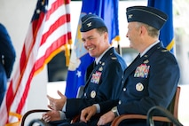 Col. Steven M. Gorski (left) shares a laugh with Col. Chad J. Hartman during their Change of Command ceremony at Patrick AFB, Fla.  Hartman assumed command of the Air Force Technical Applications Center from Gorski who served as the nuclear treaty monitoring center's commander since July 2016.  (U.S. Air Force photo by Phillip C. Sunkel IV)