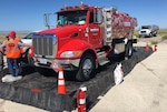A fuel truck sits with its driver outside a readiness drill.