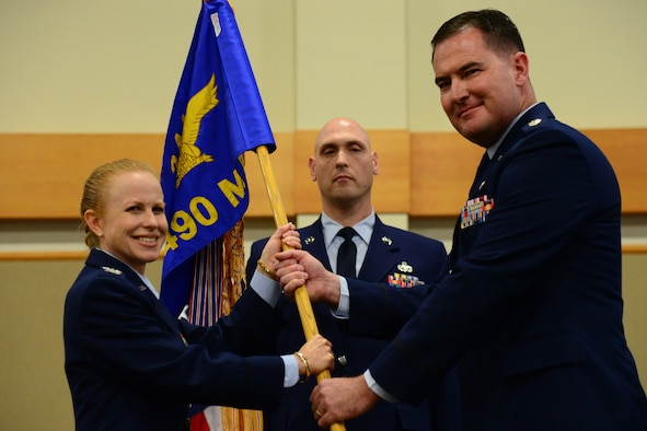 Lt. Col. Troy Stauter, right, accepts command of the 490th Missile Squadron from Col. Anita Feugate Opperman, 341st Operations Group commander, during an assumption of command ceremony June 20, 2018, at the Grizzly Bend at Malmstrom AFB, Mont.