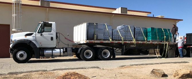 A truckload of computers is prepared at Edwards Air Force Base, California for delivery to a local school. The donation was possible because of an educational partnership agreement between the Air Force Test Center and the school district. (Courtesy photo)