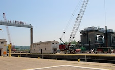 Members of the district and visit observe the work at Lock and Dam 4 on the Monongahela River at Charleroi.