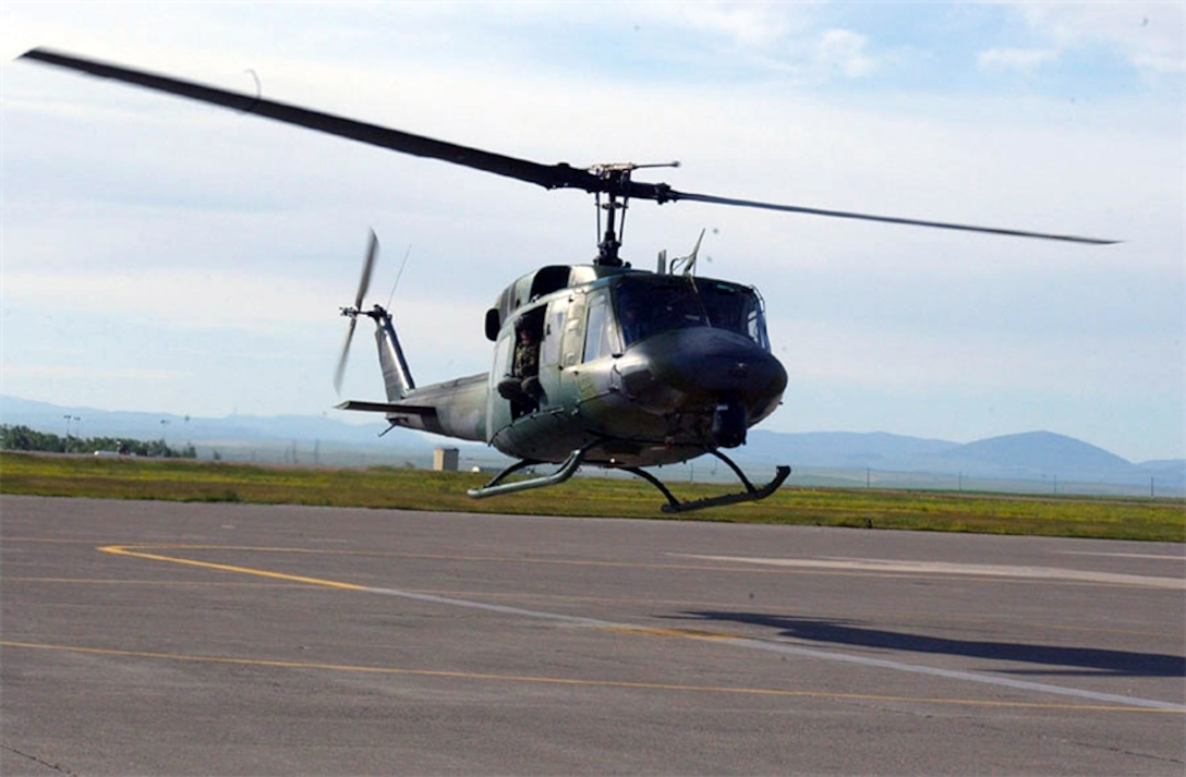 A UH-1N Huey helicopter prepares to land at Malmstrom Air Force Base, Mont. A crew assigned to the 40th Helicopter Squadron from Malmstrom AFB rescued an injured hiker Aug. 10 near Cook City, Mont., just north of the Montana-Wyoming border. (U.S. Air Force photo)