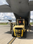 Dyess Airmen unload school supplies in Colombia