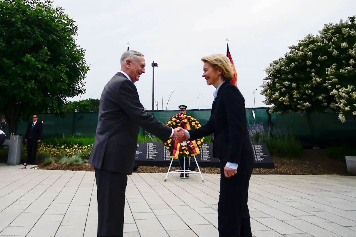 Defense Secretary James N. Mattis shakes hands with his German counterpart near a wreath outside the Pentagon.