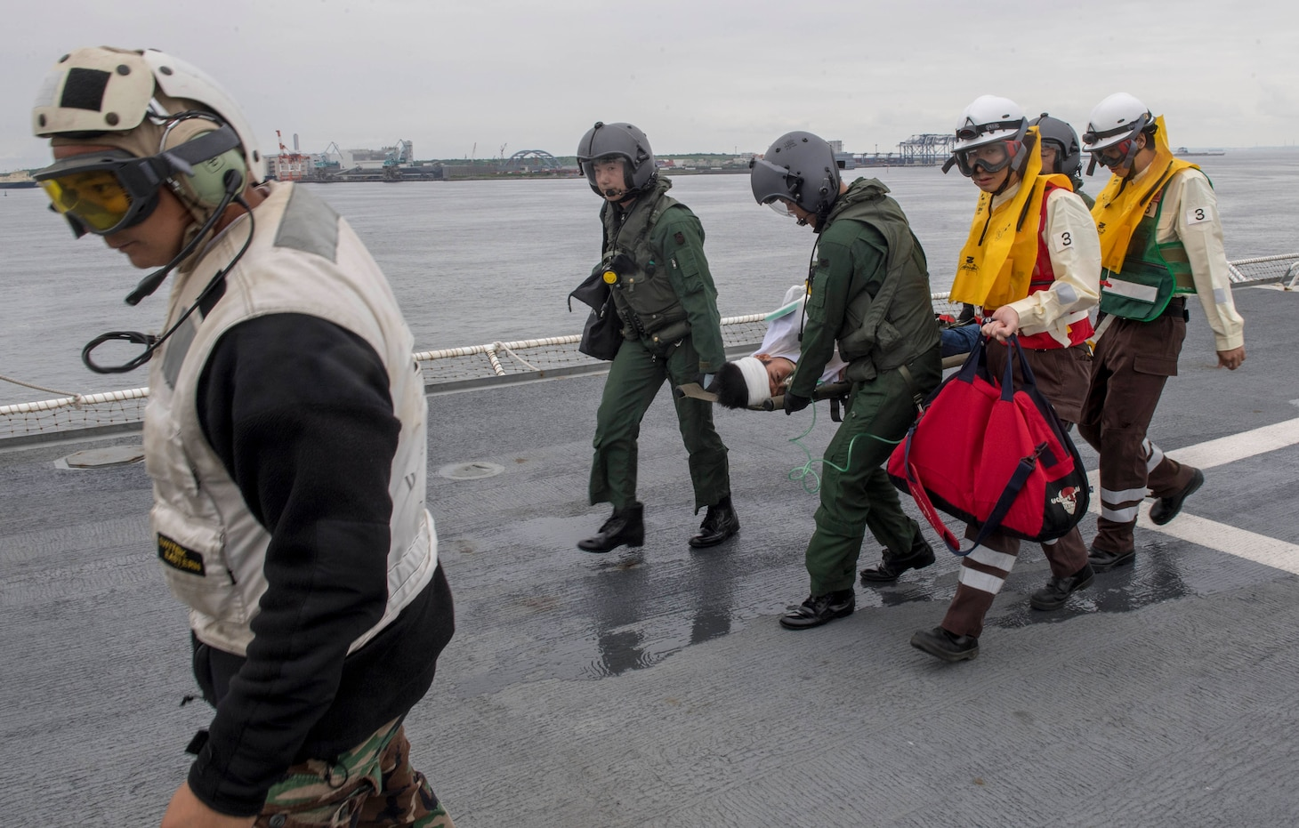 Sailors assigned to Military Sealift Command hospital ship USNS Mercy (T-AH 19) for Pacific Partnership 2018 (PP18) and Japanese Maritime Self-Defense Force (JMSDF) transfer a mock patient from an SH-60K Sea Hawk helicopter attached to the JMSDF during a bilateral medical training team drill between Mercy and JMSDF personnel. USNS Mercy is making port visits to Yokosuka and Tokyo to promote relationships between U.S. Navy Sailors and Japanese citizens through cultural exchange and bilateral training.